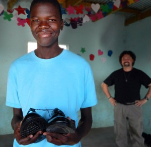 Sandile's holding his new shoes