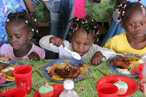 Some of the little angels from God's Littlest Angels are enjoying their Christmas dinner!